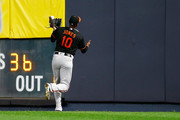 Adam Jones #10 of the Baltimore Orioles is unable to hold onto a double off the bat of Neil Walker #14 of the New York Yankees in the fourth inning at Yankee Stadium on September 21, 2018 in the Bronx borough of New York City.