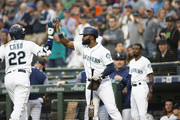 Robinson Cano #22 of the Seattle Mariners is greeted by Denard Span #4 after hitting a home run against the Baltimore Orioles in the first inning at Safeco Field on September 4, 2018 in Seattle, Washington.