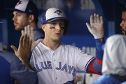Troy Tulowitzki #2 of the Toronto Blue Jays is congratulated by teammates in the dugout after hitting a solo home run in the ninth inning during MLB game action against the Baltimore Orioles at Rogers Centre on June 27, 2017 in Toronto, Canada.