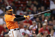 Adam Jones #10 of the Baltimore Orioles hits a single during the seventh inning against the Boston Red Sox at Fenway Park on September 26, 2018 in Boston, Massachusetts.