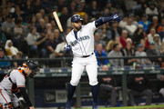 Nelson Cruz #23 of the Seattle Mariners signals at Robinson Cano #22 to advance to second on a wild pitch by Alex Cobb #17 of the Baltimore Orioles in the sixth inning at Safeco Field on September 4, 2018 in Seattle, Washington.