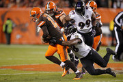 Josh McCown #13 of the Cleveland Browns gets tackled by Elvis Dumervil #58 of the Baltimore Ravens during the first quarter at FirstEnergy Stadium on November 30, 2015 in Cleveland, Ohio.
