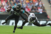 Patrick Onwuasor of the Baltimore Ravens tackles  Chris Ivory of the Jacksonville Jaguars during the NFL International Series match between Baltimore Ravens and Jacksonville Jaguars at Wembley Stadium on September 24, 2017 in London, England.
