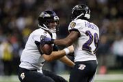 Joe Flacco #5 of the Baltimore Ravens congratulates Justin Forsett #29 following a touchdown against the New Orleans Saints during the fourth quarter of a game at the Mercedes-Benz Superdome on November 24, 2014 in New Orleans, Louisiana.