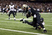 Jimmy Graham #80 of the New Orleans Saints catches a touchdown pass in front of Will Hill #33 of the Baltimore Ravens during the first quarter of a game at the Mercedes-Benz Superdome on November 24, 2014 in New Orleans, Louisiana.