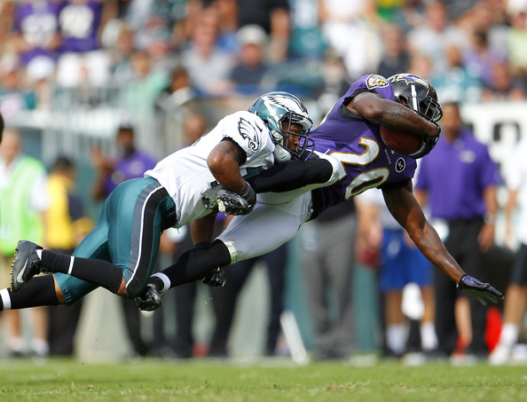 Safety Ed Reed #20 of the Baltimore Ravens is tackled by wide receiver Damaris Johnson #13 of the Philadelphia Eagles after Reed intercepted a Michael Vick pass intended for Johnson in the third quarter during a game at Lincoln Financial Field on September 16, 2012 in Philadelphia, Pennsylvania. The Eagles defeated the Ravens 24-23.