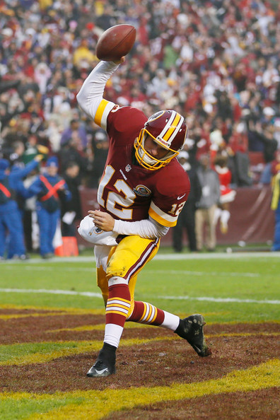 Kirk Cousins spikes the ball after scoring 2-point conversion