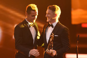 Bastian Schweinsteiger and Miroslav Klose are seen on stage during the Bambi Awards 2014 show on November 13, 2014 in Berlin, Germany.