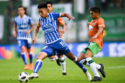 Guillermo Fernandez of Godoy Cruz fights for the ball with Juan Alvarez of Banfield during a match between Banfield and Godoy Cruz as part of Argentina Superliga 2017/18 at Florencio Sola Stadium on April 21, 2018 in Buenos Aires, Argentina.