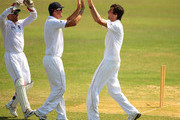 England bowler Steven Finn (r) is congratulated by fielders Matt Prior (l) and Kevin Pietersen (c) during day three of the tour match between Bangladesh A and England at Jahur Ahmed Chowdhury Stadium on March 9, 2010 in Chittagong, Bangladesh.