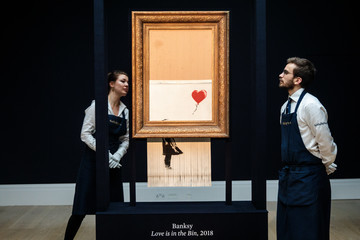 Banksy Sotheby's Unveils Banksy's Newly Completed Artwork 'Love in in the Bin'