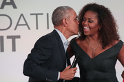 Former U.S. President Barack Obama gives his wife Michelle a kiss as they close the Obama Foundation Summit together on the campus of the Illinois Institute of Technology on October 29, 2019 in Chicago, Illinois. The Summit is an annual event hosted by the Obama Foundation.