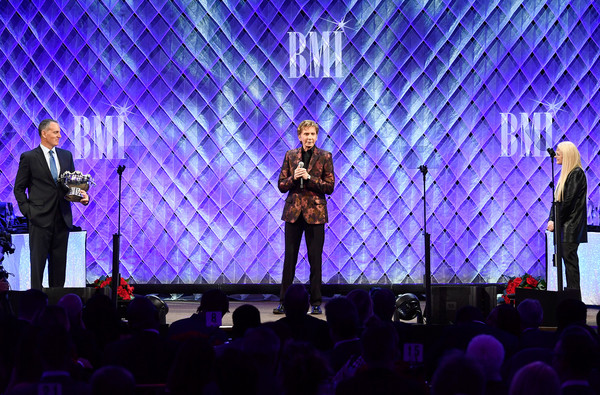 Broadcast Music, Inc (BMI) Honors Barry Manilow at the 65th Annual BMI Pop Awards - Inside [barry manilow,michael oneill,vice president,writer,general manager,ceo,bmi pop awards,relations,performance,entertainment,concert,performing arts,event,stage,purple,sky,public event,music artist,broadcast music inc bmi honors,publisher]