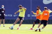 Gerard Pique of FC Barcelona plays the ball under pressure from Arturo Vidal during a training session at Ciutat Esportiva Joan Gamper on May 23, 2020 in Barcelona, Spain. Spanish LaLiga clubs are back training in groups of up to 10 players following the LaLiga's 'Return to Training' protocols.