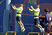 Luis Suarez and Lionel Messi of FC Barcelona work during a training session at Ciutat Esportiva Joan Gamper on May 19, 2020 in Barcelona, Spain. Spanish LaLiga clubs are back training in groups of up to 10 players following the LaLiga's 'Return to Training' protocols.