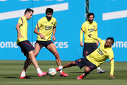 Sergio Busquets, Gerard Pique, Lionel Messi and Arturo Vidal of FC Barcelona work during a training session at Ciutat Esportiva Joan Gamper on May 19, 2020 in Barcelona, Spain. Spanish LaLiga clubs are back training in groups of up to 10 players following the LaLiga's 'Return to Training' protocols.