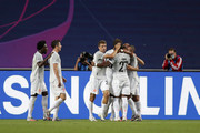 Thomas Mueller of FC Bayern Munich celebrates with teammates after scoring his team's fourth goal during the UEFA Champions League Quarter Final match between Barcelona and Bayern Munich at Estadio do Sport Lisboa e Benfica on August 14, 2020 in Lisbon, Portugal.