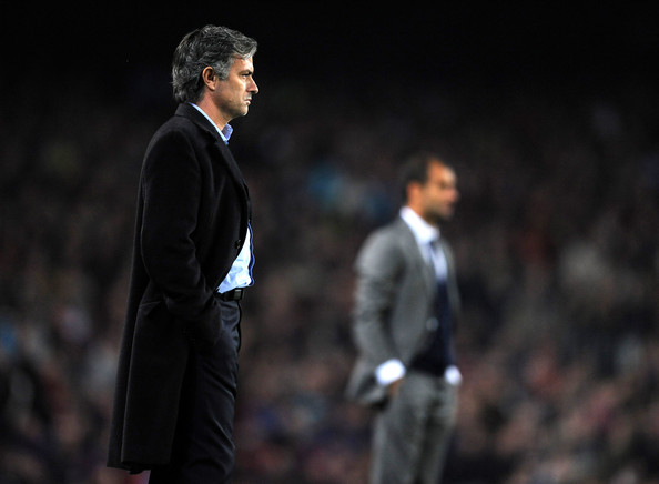 Coach Jose Mourinho of Inter Milan follows his players backdropped by coach Josep Guardiola of FC Barcelona during the UEFA Champions League group F match between FC Barcelona and Inter Milan at the Camp Nou Stadium on November 24, 2009 in Barcelona, Spain. Barcelona won the match 2-0.