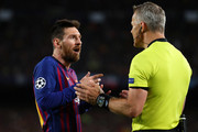 Lionel Messi of Barcelona speaks to Match Referee Bjorn Kuipers during the UEFA Champions League Semi Final first leg match between Barcelona and Liverpool at the Nou Camp on May 01, 2019 in Barcelona, Spain.