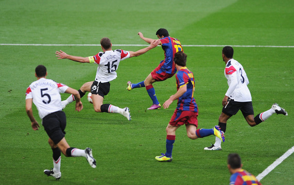 Pedro (C) of FC Barcelona scores the opening goal during the UEFA Champions League final between FC Barcelona and Manchester United FC at Wembley Stadium on May 28, 2011 in London, England.
