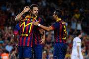 Cesc Fabregas of FC Barcelona (C) celebrates with his team-mates Neymar (L) and Alexis Sanchez after scoring his team's sixth goal during a friendly match between FC Barcelona and Santos at Nou Camp on August 2, 2013 in Barcelona, Spain.