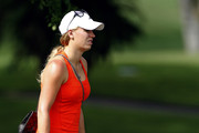Caroline Wozniacki watches Rory McIlroy of Northern Ireland during the continuation of the weather delayed first round of the Barclays Singapore Open at  the Sentosa Golf Club on November 9, 2012 in Singapore.