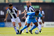 Shaq Coulthirst of Barnet in action with Gareth Barry and Martin Cranie of West Bromwich Albion during the Pre-season friendly between Barnet and West Bromwich Albion on July 7, 2018 in Barnet, United Kingdom.