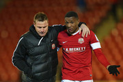 David Flitcroft the manager of Barnsley leaves the pitch with Kelvin Etuhu after victory over Brighton & Hove Albion in the npower Championship match between Barnsley and Brighton & Hove Albion at Oakwell Stadium on March 12, 2013 in Barnsley, England.