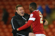 David Flitcroft the manager of Barnsley celebrates with Kelvin Etuhu after victory over Brighton & Hove Albion in the npower Championship match between Barnsley and Brighton & Hove Albion at Oakwell Stadium on March 12, 2013 in Barnsley, England.