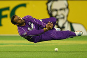 Shoaib Malik of the Hurricanes attempts to take a catch during the Big Bash League match between the Melbourne Stars and the Hobart Hurricanes at Melbourne Cricket Ground on January 21, 2014 in Melbourne, Australia.