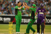 Scott Boland and Cameron White of the Stars celebrate the wicket of Shoaib Malik of the Hurricanes during the Big Bash League match between the Melbourne Stars and the Hobart Hurricanes at Melbourne Cricket Ground on January 21, 2014 in Melbourne, Australia.