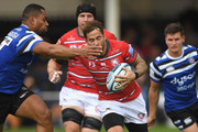 Bath wing Joe Cokanasiga grabs Gloucester player Danny Cipriani during the Gallagher Premiership Rugby match between Bath Rugby and Gloucester Rugby at Recreation Ground on September 8, 2018 in Bath, United Kingdom.