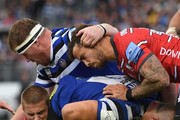 Gloucester player Danny Cipriani (r) can't stop Bath player Tom Dunn charging towards the line  during the Gallagher Premiership Rugby match between Bath Rugby and Gloucester Rugby at Recreation Ground on September 8, 2018 in Bath, United Kingdom.