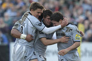 Anthony Allen (R) of Leicester is congratulated by team mates Toby Flood (L) and Ben Youngs after scoring the first try during the Aviva Premiership match between Bath and Leicester Tigers at the Recreation Ground on March 26, 2011 in Bath, England.