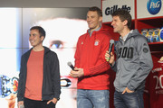 Thomas Mueller, Mario Goetze and goalkeeper Manuel Neuer (L-R) of Bayern Muenchen smile during the official presentation of the new FC Bayern Muenchen sponsoring partner Procter & Gamble at Allianz Arena Erlebniswelt on April 20, 2016 in Munich, Germany.