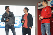 Thomas Mueller, Mario Goetze and goalkeeper Manuel Neuer (L-R) of Bayern Muenchen chat during the official presentation of the new FC Bayern Muenchen sponsoring partner Procter & Gamble at Allianz Arena Erlebniswelt on April 20, 2016 in Munich, Germany.