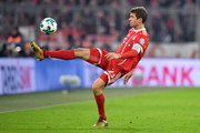 Thomas Mueller of Bayern Muenchen controls the ball during the DFB Cup match between Bayern Muenchen and Borussia Dortmund at Allianz Arena on December 20, 2017 in Munich, Germany.