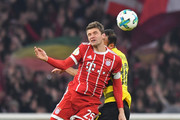 Thomas Mueller of Bayern Muenchen and Omer Toprak of Borussia Dortmund battle for a header during the DFB Cup match between Bayern Muenchen and Borussia Dortmund at Allianz Arena on December 20, 2017 in Munich, Germany.