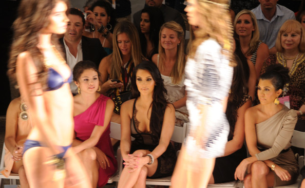Selena Gomez (L-R) Selena Gomez, Kim Kardashian and Kourtney Kardashian attend the Beach Bunny Swimwear 2011 fashion show during Mercedes-Benz Fashion Week Swim at the Raleigh on July 16, 2010 in Miami Beach, Florida.