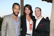 (L - R)  Recording artist John Legend, Christine Teigen, Phil Reese attend The Beacon Condominiums Celebrates the Spring Issue Of Athletes Quarterly at The Beacon Condominiums on May 20, 2010 in Jersey City, New Jersey.