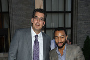 George Filopoulos, CEO of Metrovest Equiities and recording artist John Legend attend The Beacon Condominiums Celebrates the Spring Issue Of Athletes Quarterly at The Beacon Condominiums on May 20, 2010 in Jersey City, New Jersey.