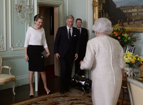 Queen Elizabeth II (R) greets King Philippe and Queen Mathilde of Belgium at Buckingham Palace on March 13, 2014 in London, England. King Philippe and Queen Mathilde of Belgium are on an official one day trip to London.