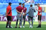 Vincent Kompany and Kevin De Bruyne of Belgium talk to John Stones, Kyle Walker and Fabian Delph of England during a pitch inspection prior to the 2018 FIFA World Cup Russia 3rd Place Playoff match between Belgium and England at Saint Petersburg Stadium on July 14, 2018 in Saint Petersburg, Russia.