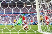 Eden Hazard of Belgium scores Jordan Pickford of England his team's second goal during the 2018 FIFA World Cup Russia 3rd Place Playoff match between Belgium and England at Saint Petersburg Stadium on July 14, 2018 in Saint Petersburg, Russia.
