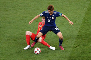 Yuya Osako of Japan is challenged by Kevin De Bruyne of Belgium during the 2018 FIFA World Cup Russia Round of 16 match between Belgium and Japan at Rostov Arena on July 2, 2018 in Rostov-on-Don, Russia.