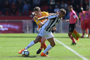 Filip Djuricic of Benevento Calcio vies with Claudio Marchisio of Juventus during the serie A match between Benevento Calcio and Juventus at Stadio Ciro Vigorito on April 7, 2018 in Benevento, Italy.