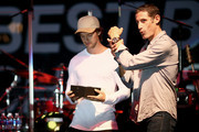 (L-R) Actor Patrick Schwarzenegger and professional cyclist George Hincapie speak onstage at the Hearst Ranch Barbeque, Celebration and Concert during the Best Buddies Hearst Castle Challenge at Hearst Ranch on September 12, 2015 in San Simeon, California.