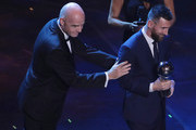 Lionel Messi receives The Best FIFA Men's Player of the Year award by FIFA President Gianni Infantino during The Best FIFA Football Awards 2019 at Teatro alla Scala on September 23, 2019 in Milan, Italy.