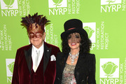 Clive Davis and Joan Collins attend Bette Midler's Hulaween To Benefit NY Restoration Project at New York Midtown Hilton on October 31, 2019 in New York City.