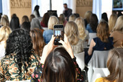 A guest takes a photo with her cell phone as Jennifer Stagg of Stagg Design (L) and Designer Bobby Berk speak during Better Homes & Gardens Stylemaker 2019 at PUBLIC Hotel on September 19, 2019 in New York City.
